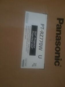 White Panasonic PT-RZ770 w u  7200-Lumen WUXGA DLP Projector. New in box