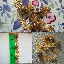 NEW 10 x crystal bronze bead with gold flower on top and leave hanging.