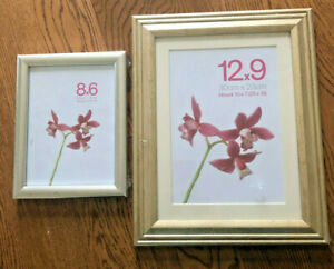 2 X PICTURE FRAMES NEW IN PACKAGING. ALL PROCEEDS TO CHARITY