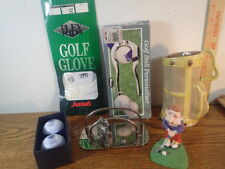 a lot of vintage golf accessories and collectibles