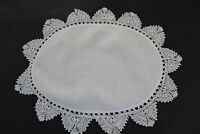 Vintage oval shaped white linen cloth with crochet edges.