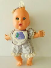 "Gerber Products Co.1996 Toy Biz Inc.Baby Grapes Doll 8 1/2""Tall"