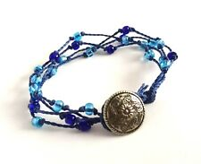 4 Strand Bracelet with Button Fastening. Blue. Waxed Cotton. Glass Beads.