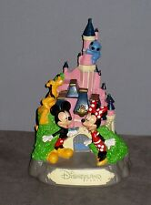 Tirelire Château Disneyland  Avec Mickey/Minnie/Pluto/Stitch ( haut 21 cm)