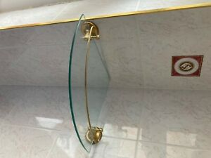 Brass/Glass corner shelf with rail