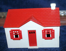 An original Littletown (pre-Plasticville) No. 102 red/white Cape Cod Cottage
