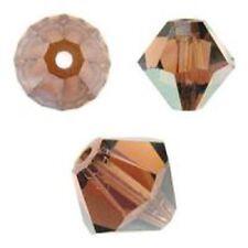 Swarovski Crystal Bicone Smoked Topaz AB. 6mm. Approx. 48 PCS. 5328