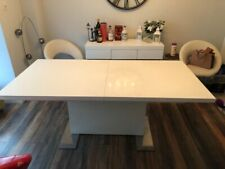 white high gloss extending dining table, 6 Leather swivel Chairs and sideboard