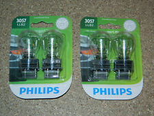 (2) PACKS OF 2 PHILIPS LONGER LIFE 3057 TAIL LIGHT BULBS 3057LLB2 TURN SIGNAL