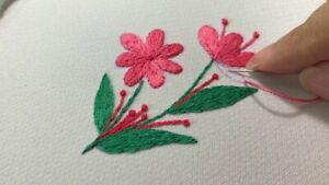 Old towels embroidered with simple flowers, embroidered towels from thread