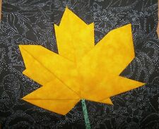 4 Paper Pieced Golden Yellow Maple Leaf on black background quilt block