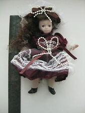 Vintage full porcelain small doll with beret
