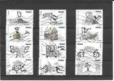 FRANCE 2010.SOURIRES.SERIE COMPLETE DE 12 TIMBRES AA OBLITERE