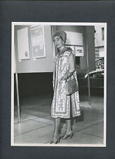JOAN CRAWFORD MODELS A PERUVIAN-STYLE COAT DESIGNED BY EDITH HEAD - 1962 CANDID