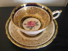 PARAGON COBALT BLUE GOLD CHINTZ PINK ROSE BOTTOM TEACUP AND SAUCER