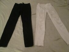 2 pair of women's American Eagle jeans, one black and one white, both size 4