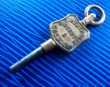 Advertising Pocket Watch Key  -  R. J. Heathcote of Derby & Gresley , Derbyshire