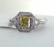 1.51 carat Fancy Natural Yellow Radiant Cut Diamond w/ 2 trillions Gold Ring GIA