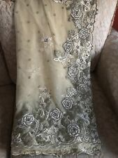 An Off White net saree and blouse  with beautiful embroidery and stone work