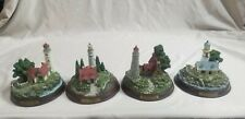 Four (4) Thomas Kinkade Vintage Lighthouse Figurines