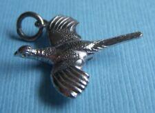 Vintage Wells bird in flight sterling charm