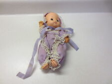 Vintage Uneeda Doll Company Doll baby doll with purple outfit with white lace