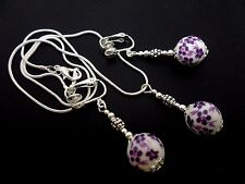 A PRETTY PURPLE PORCELAIN FLOWER BEAD NECKLACE AND  CLIP ON EARRING SET. NEW.