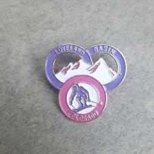 LOVELAND BASIN Pink Purple Three Rings Resorts Skier Ski Pin ~ CO Colorado