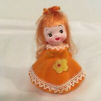 Napcoware Ceramic Figurine with Fiber Hair - Girl w/ Orange Hair, Flower M-7946