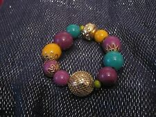 Elasticated beaded bracelet with feature beads in various colours and designs