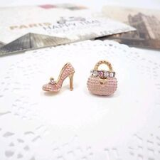 Intriguing gold hand bag and high heels in classic pink  stud earrings