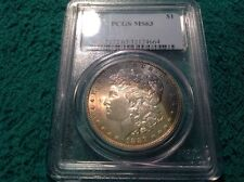 1887 rainbow toned pcgs ms 63 morgan silver dollar.