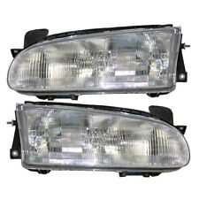 93-97 Geo Prizm Set of Headlights