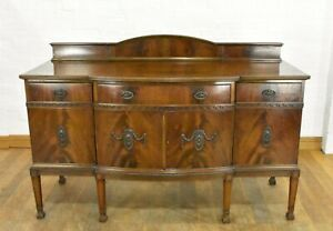 Antique large bow front sideboard