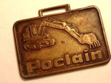 older brass Poclain heavy equipment advertising watch fob