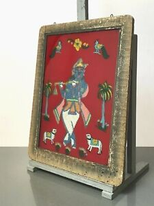 VINTAGE INDIAN REVERSE GLASS AND BEAD PAINTING. KRISHNA WITH SACRED CALVES.