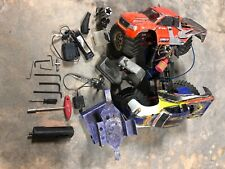 Traxxas T Maxx. Runs good. Just needs a tuning. Comes with spare engine.