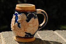 Vintage small German Stein with couple and house embossed