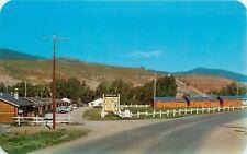 Dubois Wyoming~Branding Iron Motel~Log Cabins~Hills~Nice 1950s Cars~Post Card