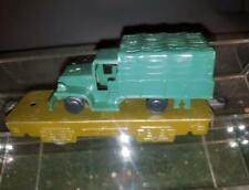 "Marx 4-Wheel  6""  Tinplate Olive Drab Army Flat Car with 4 Wheel Transport load."