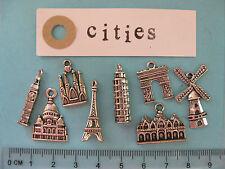 8 tibetan silver charms on cities Paris Barcelona Venice London Pisa Amsterdam