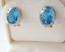 Oval Cut Blue Topaz 12*16 Omega Back French Clip 14k Yellow Gold Earrings