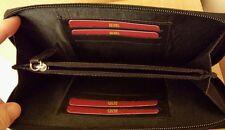 Black clutch purse with zip around fastening