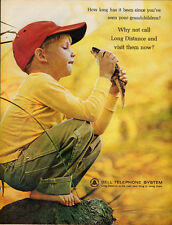 1964 Vintage ad for Bell Telephone System~Little boy holding a fish/red cap