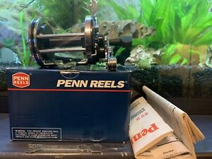 *NEW UNUSED* Penn Reels 140L Squidder (LH) Baitcaster Fishing Reel in Silver