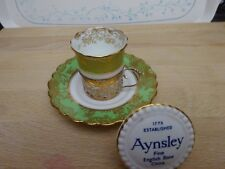Aynsley China Coffee Can & Saucer with a Silver Holder
