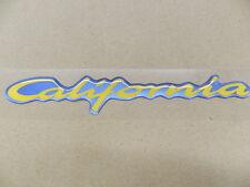 Emblem California gelb/hellblau Astra F ORIGINAL OPEL 6101516