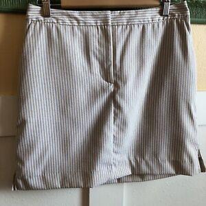 Izod XFG golf Skort Size 4 Tan White Stripe Tennis Athleisure