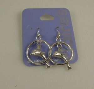 swimming dolphins silvertone earrings dangle Claires sensitive solutions dolphin