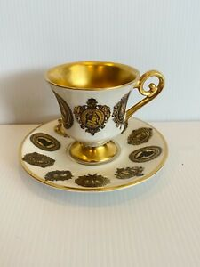 ALKA - KUNST ALBOTH & KAISER GOLD WHITE CAMEO DEMITASSE CUP WITH SAUCER